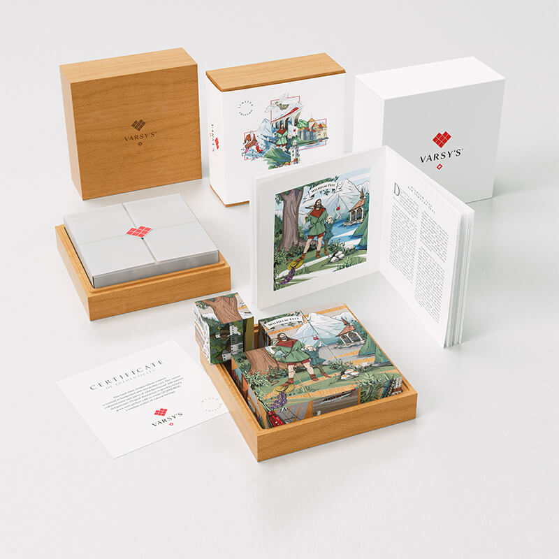 [:en]Set 2 of VARSY'S Legendbox Limited Edition includes 9 beechwood cubes, a booklet with Swiss legends like the story of William Tell and a certificate in a massive wooden box.[:de]VARSY'S Legendenbox Set 2 beinhaltet 9 Holzwürfel, ein Buch mit Schweizer Legenden, wie der Geschichte von Wilhelm Tell und ein Zertifikat in einer massiven Holzbox.[:]